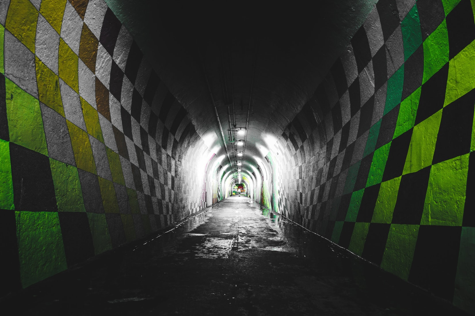 Green and white checkered painted tunnel