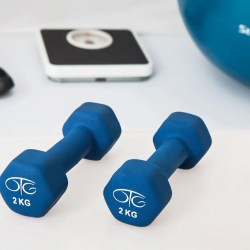 Weight lifting equipment: Blue dumbbells next to weight scale and shoes