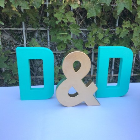 Our initials hand painted in aqua and gold