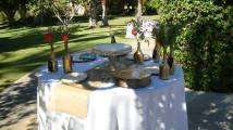Glass bottles spray-painted gold helped to create our rustic-chic centrepieces