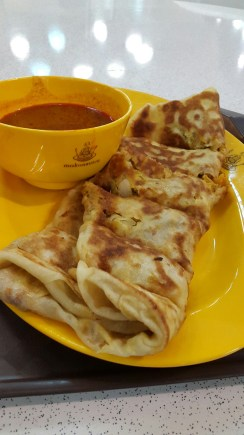 Murtabak - a roti wrap filled with curried chicken, egg and onion, with a chilli sauce for dipping
