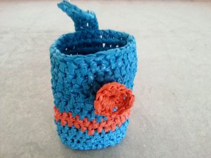 Crochet crafts made with plarn [a yarn made by cutting plastic bags into a string]