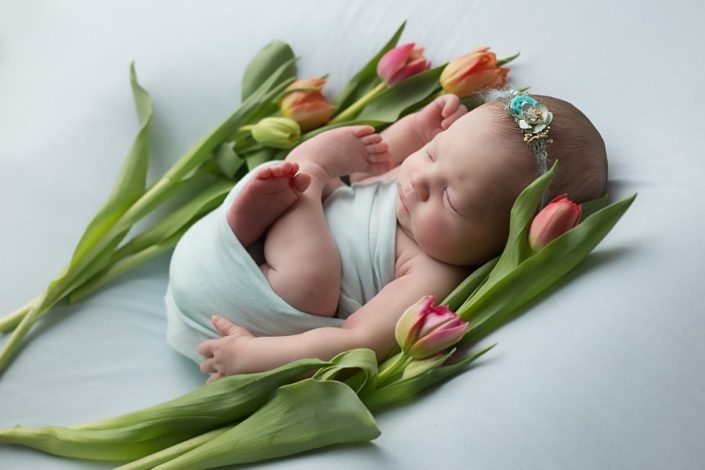Baby Photographer Glasgow - baby lying on flowers