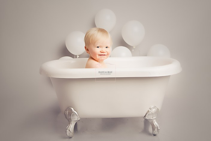 Cake Smash Photo Shoot - baby smiling in bath tub