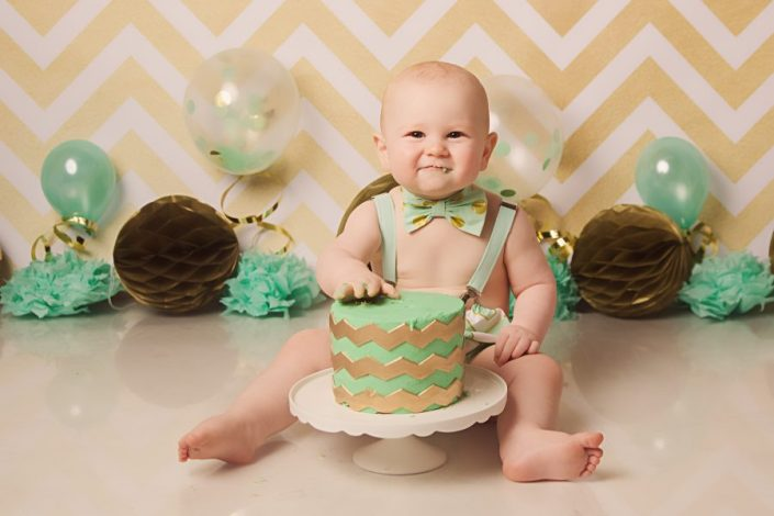 1st birthday cake smash glasgow - baby boy with birthday cake