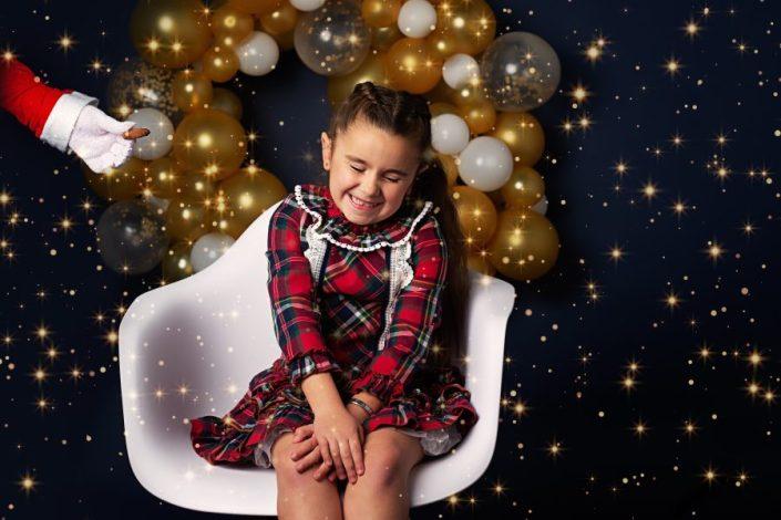 Family Photographer Renfrewshire - girl in tartan dress