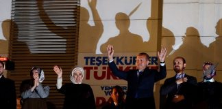 Turkish Prime Minister Recep Tayyip Erdogan (C) cheers to supporters of Turkey's ruling party Justice and Development Party (AKP) with his wife Emine (3rd-L), his daughters Esra Albayrak (2nd-L) and Sumeyye Erdogan (2nd-R), his son Bilal Erdogan (3rd-R) and his son-in-law Berat Albayrak (L) at AKP headquarter after being announced results of local elections in Ankara, Turkey 30 March 2014