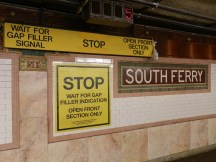 These signs remind train conductors, situated in the middle of the ten-car trains, to wait for gap fillers to extend and to open the doors of only the front five cars.