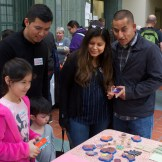 Family looking at rubber stamps