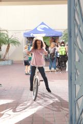 Women on a bike smiling