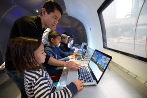 families working on computers in airstream