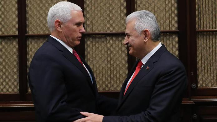 Turkish Prime Minister Binali Yildirim (R) meets US Vice President Mike Pence (L) at the Roosevelt Room in the White House in Washington, United States. November 09, 2017.