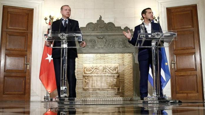 Greek Prime Minister Alexis Tsipras and Turkish President Tayyip Erdogan attend a press conference following their meeting at the Maximos Mansion in Athens. December 7, 2017.