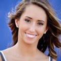 Pretty girl on a blue background. Dallas Mavs dancer headshot.
