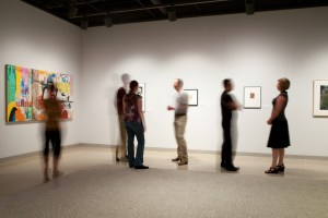 Blurry people at an art gallery video with photography