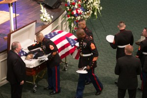 Marines approaching their friend at his funeral