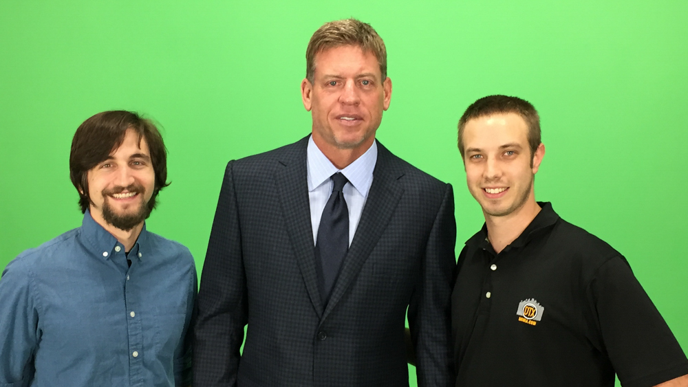 The DTX Media video crew: Michael and Jonny, posing in front of a green screen with Dallas Cowboys Super Bowl champion Troy Aikman on-set.