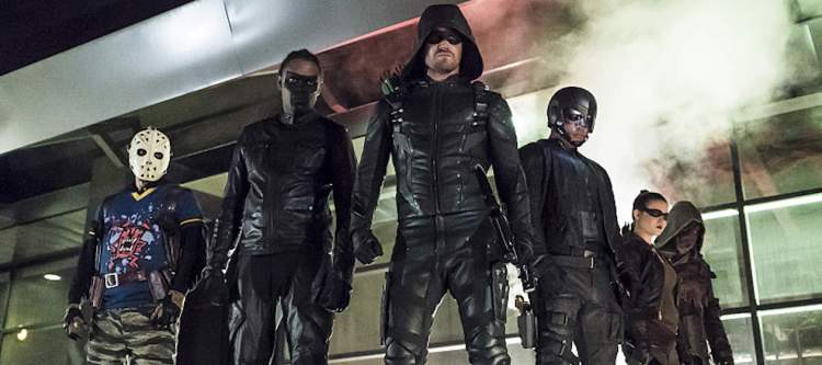 "Arrow -- ""So It Begins"" -- Image AR506b_0067b.jpg -- Pictured (L-R):  Rick Gonzalez as Rene Ramirez/Wild Dog,  Echo Kellum as Curtis Holt/Mr.Terrific, Stephen Amell as Oliver Queen/The Green Arrow, David Ramsey as John Diggle/Spartan, Madison McLaughlin as Evelyn Sharp/Artemis, and Joe Dinicol as Rory Regan/Ragman -- Photo: Katie Yu/The CW -- © 2016 The CW Network, LLC. All Rights Reserved."