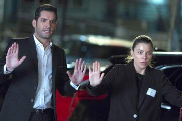"LUCIFER: L-R: Tom Ellis and Lauren German in the ""Deceptive Little Parasite"" episode of LUCIFER airing Monday, May 8 (9:01-10:00 PM ET/PT) on FOX. Cr: Michael Courtney/FOX"