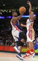 Dwyane Wade holds off a defender