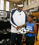 Elton Brand hands young athlete a pair of EB2s at the Converse Open Gym.