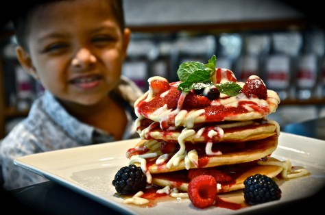 Signature Pancake - dhs 50 - Mascarpone cream, red berry purée, maple syrup & fresh berries