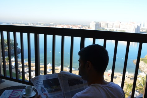 Enjoying the weather and the morning newspaper from the balcony of the Executive Suite