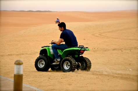 Me enjoying thje Quad bike safari at Tilal Liwa Hotel