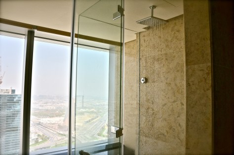 Rain shower with a wide open view of the skyline at the spacious Executive Suite bathroom