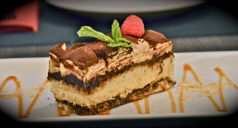 Tiramisu - dhs 35 - House-made with ladyngers soaked in espresso, layered with fresh mascarpone cheese