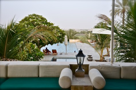 Swimming pool with a view of the Desert Palm green open fields