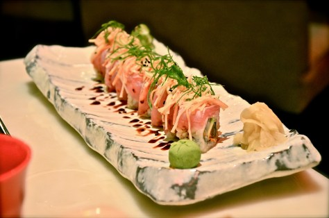 Passion Torch Roll - AED 55 - Tuna, salmon, avocado, tobiko, soya reduction