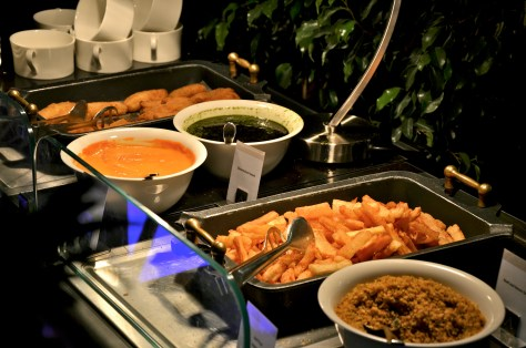 Banana Fried and Fried Yucca along with different sauces(chimmichurri, farofa, criola)
