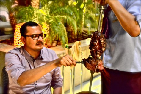 Diners inspecting the Grilled meat arrived at the table
