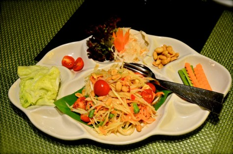 Green Papaya Salad (AED 50)- SOM TOM with long bean cherry tomato and tamarind dressing