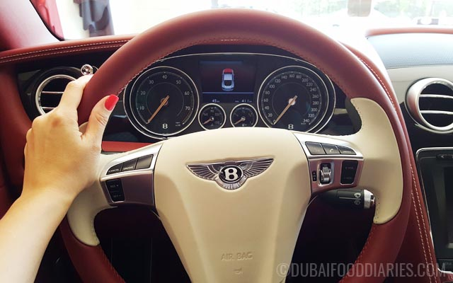 Inside red Bentley at Bentley Cafe in Dubai Marina