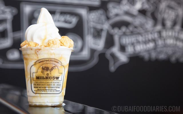 Pop Star soft serve ice cream with caramel syrup and caramel popcorn at Milkcow JBR Dubai