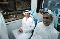 Hussain Nasser Lootah, Director -General of Dubai Municipality, and other officials take the Metro (top) to mark the Car Free Day on Wednesday.—KT photos by Shakil Qaiser