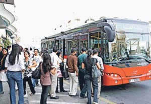 *  Residents queue for the bus in Satwa. RTA inspectors are keeping a close watch on drivers to ensure the safety of passengers.     * Image Credit: Gulf News Archive