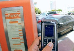 *  A motorist uses the mParking service by sending an SMS through his mobile phone at a paid parking zone on Shaikh Zayed road.     * Image Credit: Virendra Saklani/Gulf News