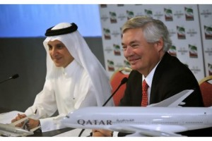 Akbar Al Baker, left, the chief executive of Qatar Airways, and John Leahy, the chief operating officer of Airbus, announce an order for 50 A320neo and five A380 aircraft valued at $6.4 billion at the Dubai Airshow yesterday. P Pigeyre / EPA