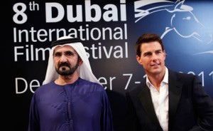 """His Highness Sheikh Mohammed bin Rashid Al Maktoum ((L), Vice-President and Prime Minister of the UAE and Ruler of Dubai, poses at the red carpet with US actor Tom Cruise as they arrive during the opening ceremony of the 8th Dubai International Film Festival for the premiere of Cruise's new movie """"Mission Impossible: Ghost Protocol"""" December 7, 2011. (REUTERS)"""