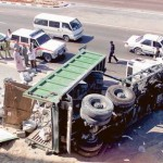 Image Credit: Gulf News archives     A truck loaded with boulders turns on its side in an accident on a construction site in Satwa.