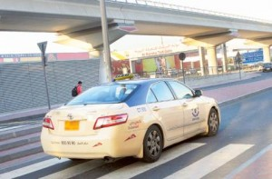 Image Credit: Virendra Saklani/Gulf News     A taxi passing through the slip road near Al Barsha toll gate. Some passengers are complaining that few taxies are being charged salik even on the slip road.