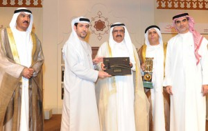 Shaikh Hamdan bin Rashid presenting the award to one of the winners as, Hussain Nasser Lootah and other officials look on during the ceremony in Dubai on Wednesday. — Supplied photo
