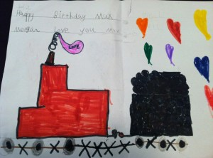 Girl Next Door thinks she's going to marry BB and doesn't mind that he only talks about trains and ships. This is the birthday card she made for him – look at the kisses on the track, the hearts coming out the coal and the word 'Love' in the smoke stack. Cute!