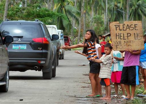 The aftermath: Children beg for food from passing motorists in Borbon town, Cebu. Photo from NBC News
