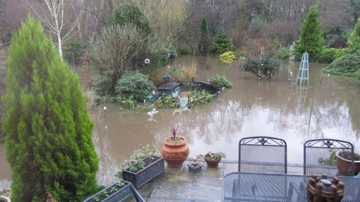 Dad's lawn turned into a lake, thanks to the river at the bottom of the garden