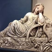 The Maid of Erin, by Burnett, shown weeping in despair with her harp in bondage, evoking the plight of her country and its people.