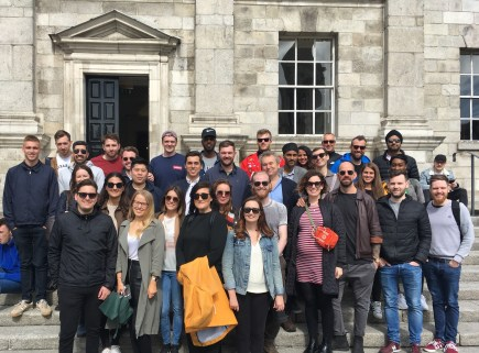 Arran Henderson of Dublin Decoded Tours with guests from Glenn Howells architects group outside Trinity College Dining Hall